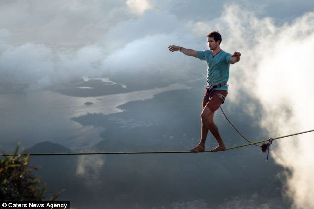Among the clouds: Fearless Mosbaugh walks almost 3,000ft above Rio de Janeiro with only a waist-tied harness