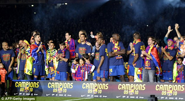 The Barca players celebrate with the trophy after retaining the La Liga title on the final day in 2010
