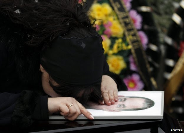 A relative grieves over the coffin of a victim of the Volgograd attacks, 31 December