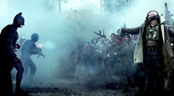 Batman (Christian Bale) and Bane (Tom Hardy) prepare to do battle in THE DARK KNIGHT RISES.