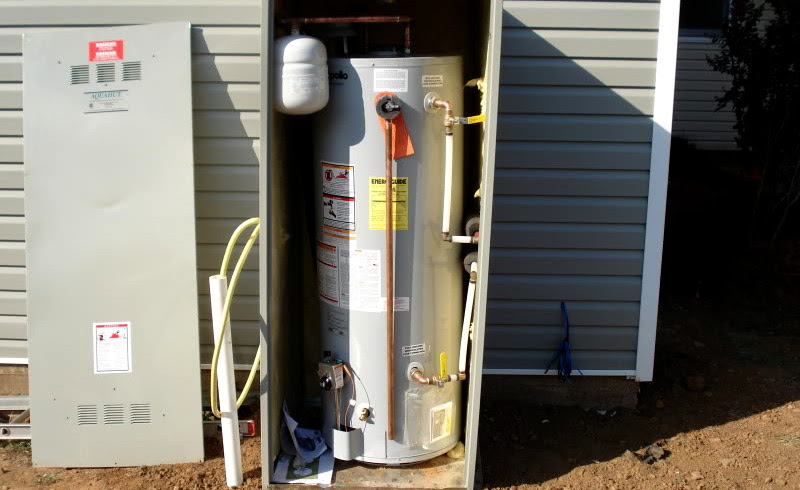 Water heater outside enclosure