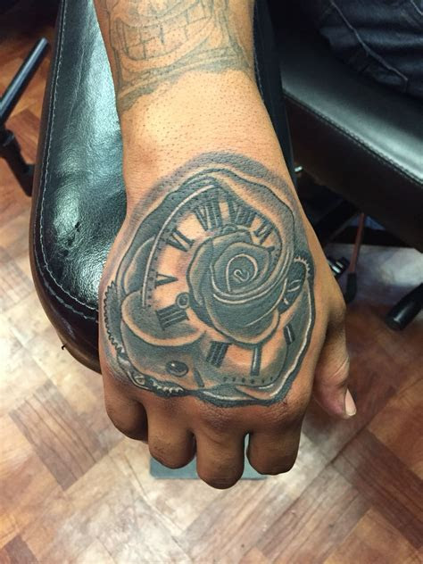 cool rose clock hand tattoo hand tattoos