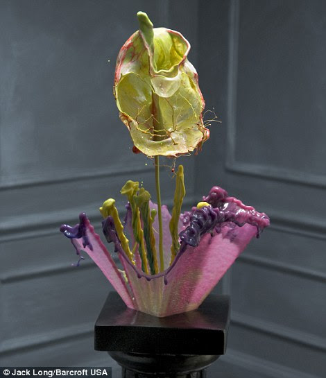 Sculpture: This pink, purple and yellow creation is posed up on a pedestal