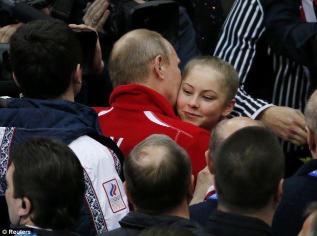 New darling: Julia Lipnitskaia of Russia's figure skating team is greeted Russia's President Vladimir Putin