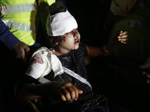 A girl who was injured in a suicide bomb blast is rushed