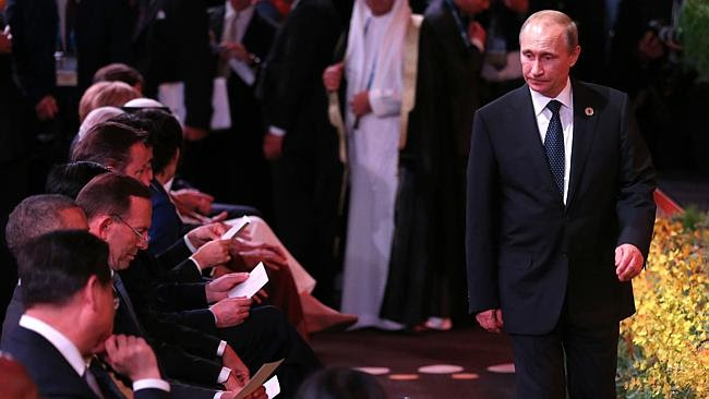 Russian President Vladimir Putin is ignored as he walks past other world leaders at the G