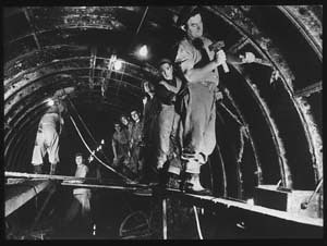 Interior of tunnel with construction gang at work