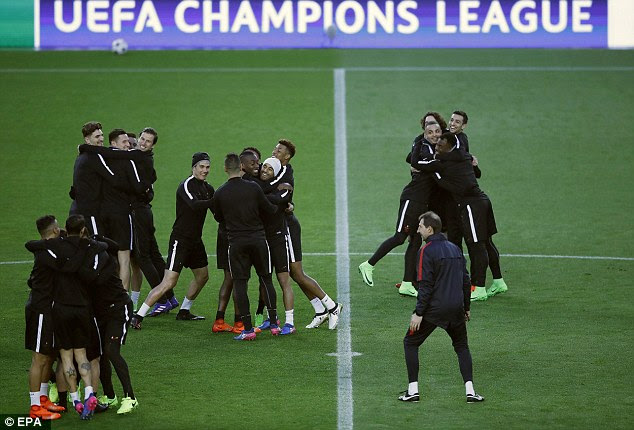 Paris Saint-Germain's players hug each other as part of the training session on Tuesday