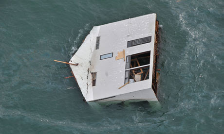 A house adrift off the coast of north eastern Japan following the earthquake and tsunami