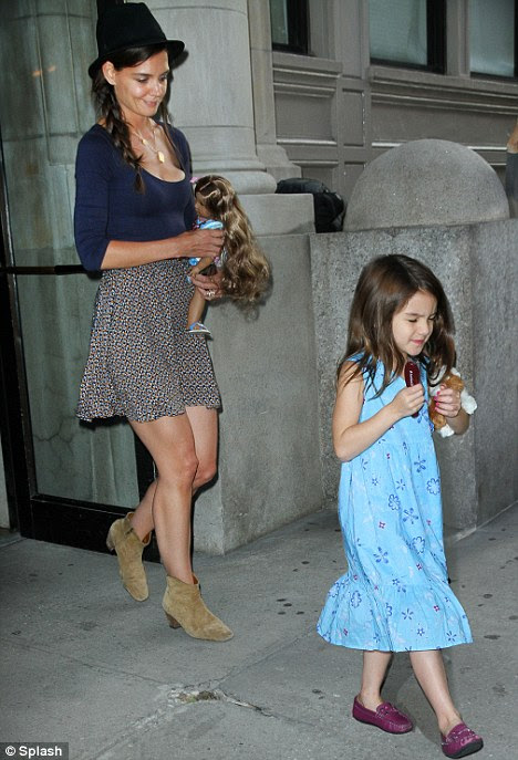 Not happy: An irritable Suri Cruise starts to throw a tantrum as she boards a private helicopter with mom Katie Holmes