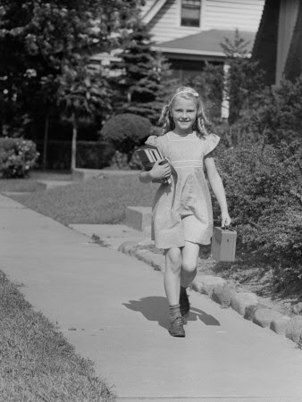 Portrait of Young Girl (8-9) With Lunch Box on Sidewalk Photographic Print