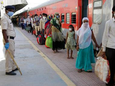 File image of migrant labourers waiting to board a special train in Gujarat. AP