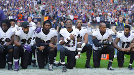 NFL players, coaches, owners kneel, lock arms during national anthem