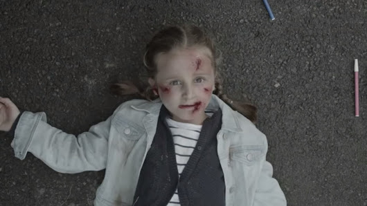 'Shock ad' campaign depicts dying girl bleeding on the road - NEWS 1130