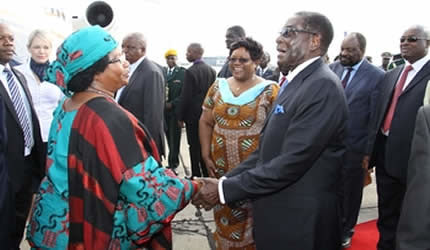 President Mugabe welcomes Malawian president Joyce Banda while Vice President Joice Mujuru looks on at the Harare International Airport April 23, 2013. The Malawian leader flew in for a State visit during which she will open the International Trade Fair. by Pan-African News Wire File Photos
