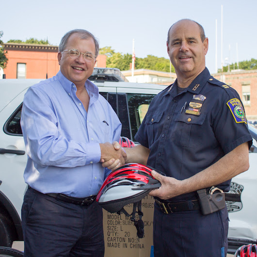 Breakstone, White & Gluck Donates 100 Children's Bicycle Helmets to Everett Police Department