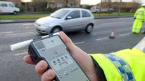 A police officer holds a breath test kit in Doncaster