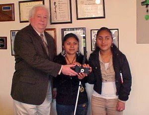 a KNFB reader being awarded to two students at the California School for the Blind