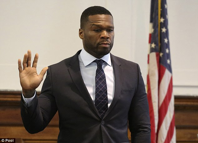 Zero cents: 50 Cent, whose real name is Curtis James Jackson III (pictured taking the oath in New York  in July 2015 during a sex tape lawsuit), says that he used the fake money to promote his 'brand'