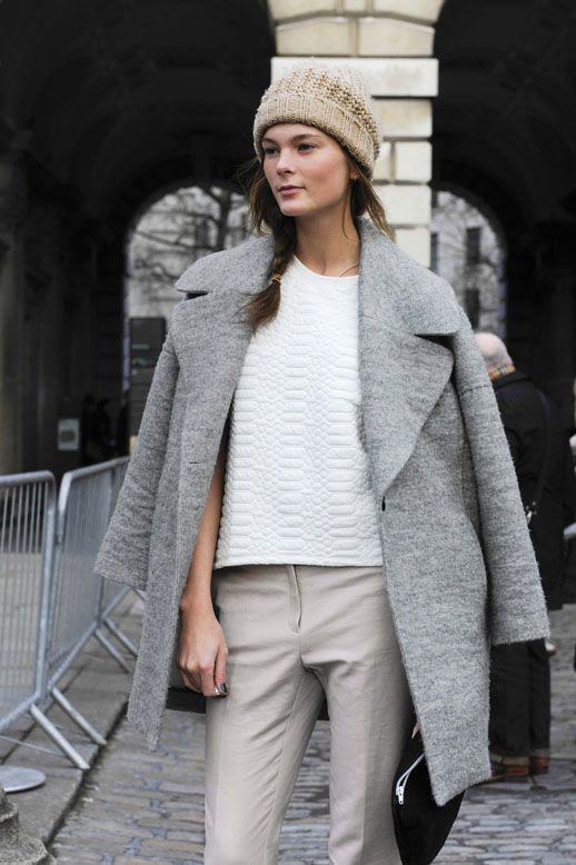 LE FASHION BLOG MODEL OFF DUTY STREET STYLE IRINA KULIKOVA LONDON FASHION WEEK LOOSE SIDE BRAID KNIT BEANIE HAT GREY DOUBLE BREASTED COAT PYTHON EMBOSSED WHITE TOP CROPPED KHAKI BEIGE TROUSERS PANTS BLACK SUEDE ANKLE BOOTS BLACK CLUTCH BAG 1 photo LEFASHIONBLOGMODELOFFDUTYSTREETSTYLEIRINAKULIKOVA1.jpg