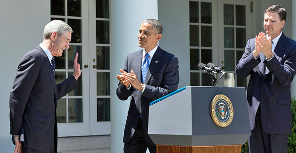 Then-FBI Director Robert Mueller, left, acknowledges applause during then-President Barack Obama's remarks on June 21, 2013. Obama had announced James Comey, right, as his nominee to succeed Mueller as FBI director (Official White House photo)