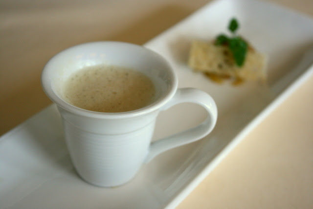 Mushroom soup with crisp Parmesan cheese