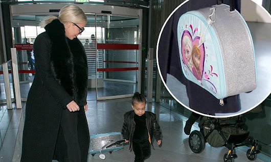 North West pulls Frozen suitcase as she jets out of Paris with Kim