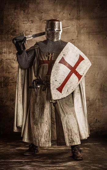 a knight templar in full uniform and armor