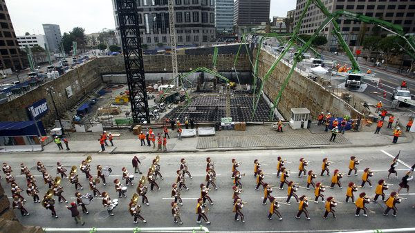 USC's marching band kicks off a Guinness Record-setting concrete pour at the Wilshire Grand Center's construction site in downtown Los Angeles, on February 15, 2014.