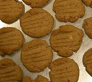 Peanut butter cookies, cooked and on the bakin...
