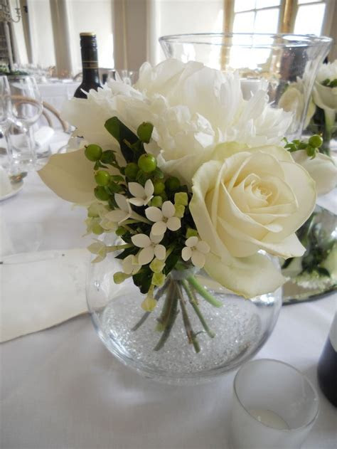Ivory floral wedding breakfast table display with glass