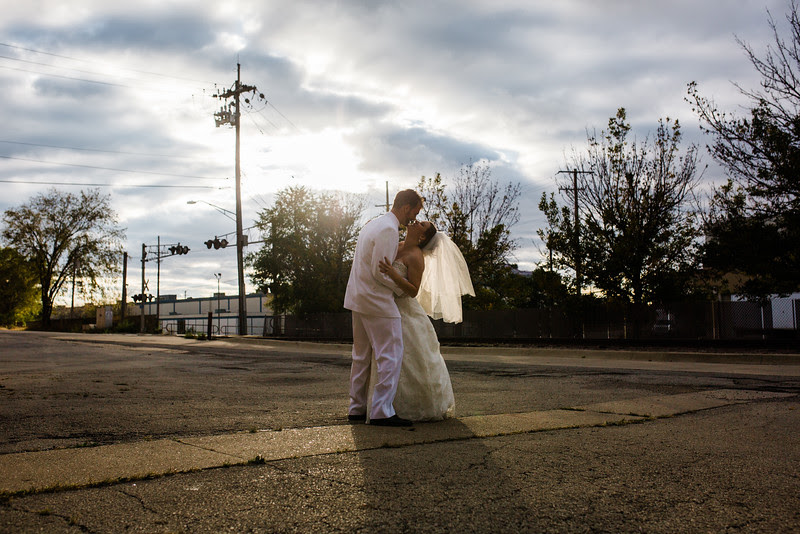 The Bride and Groom get photos taken around in downtown Rockford Illinois following their wedding at Court Street United Methodist Church for an Autumn wedding before heading to their Reception at Rockford Women's club.