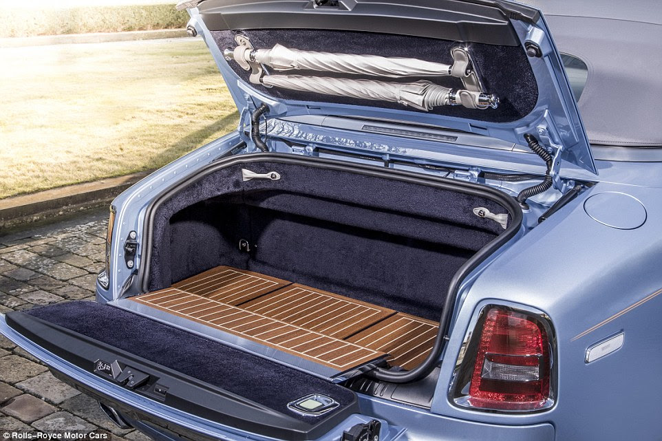 As well as two custom-made umbrella attached to the boot lid, the floor is a mix of teak and white mapel