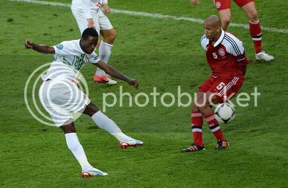 Portuguese forward Silvestre Varela shoots to score against Denmark