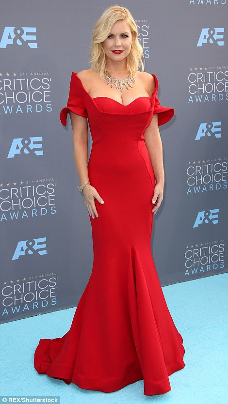 Frill seekers:Carrie Keagan (L) andTiziana Rocca went for ruffled looks for the star-studded affair
