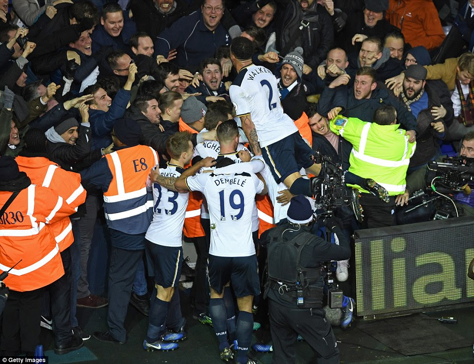 The Tottenham players including England defender Kyle Walker join in on the celebrations with the delighted home fans