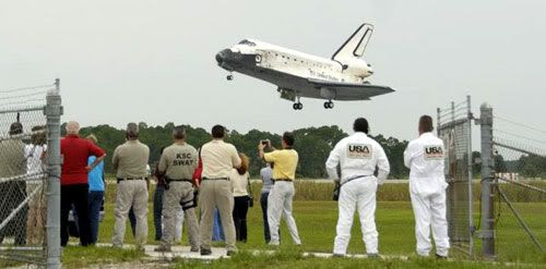 Space shuttle Discovery touches down at the Kennedy Space Center in Florida following a 13-day mission to the International Space Station.