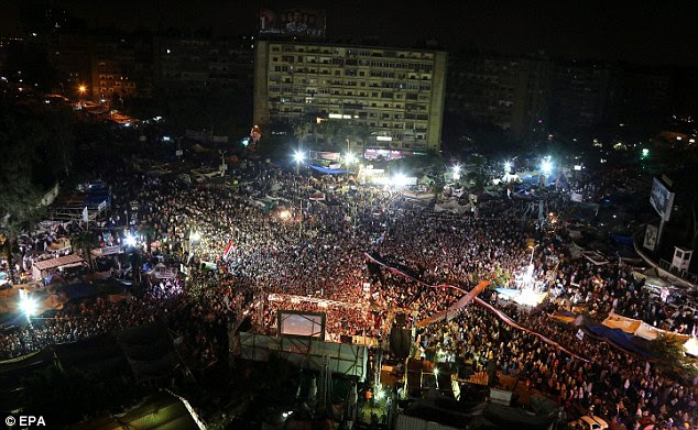 Huge gathering: Supporters of ousted President Mohamed Morsi gather as they protest near Rabaa Adawiya Mosque in Cairo last night