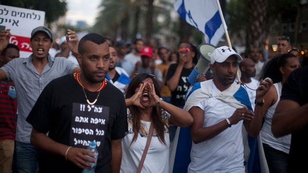 Israelis of Ethiopian descent and their supporters protest against alleged police racism and brutality on 22 June 2015 in Tel Aviv, Israel