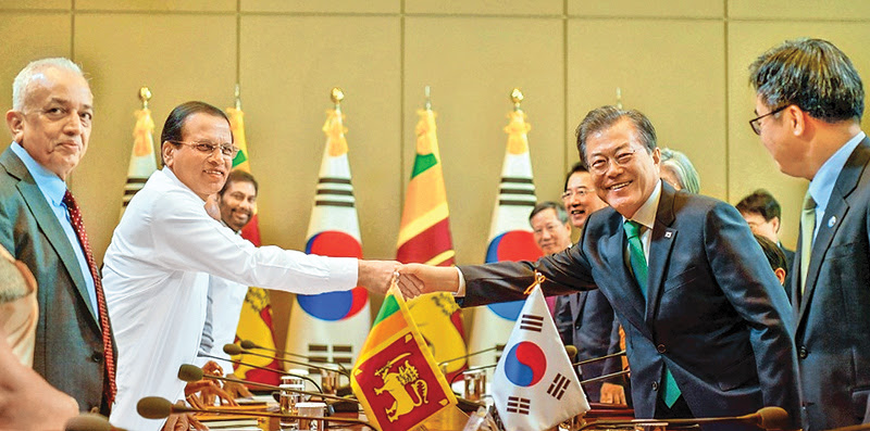 President Maithripala Sirisena who is on an official visit to South Korea held discussions with President Moon Jae-in at the Blue House in Seoul yesterday. Picture by Sudath Silva.