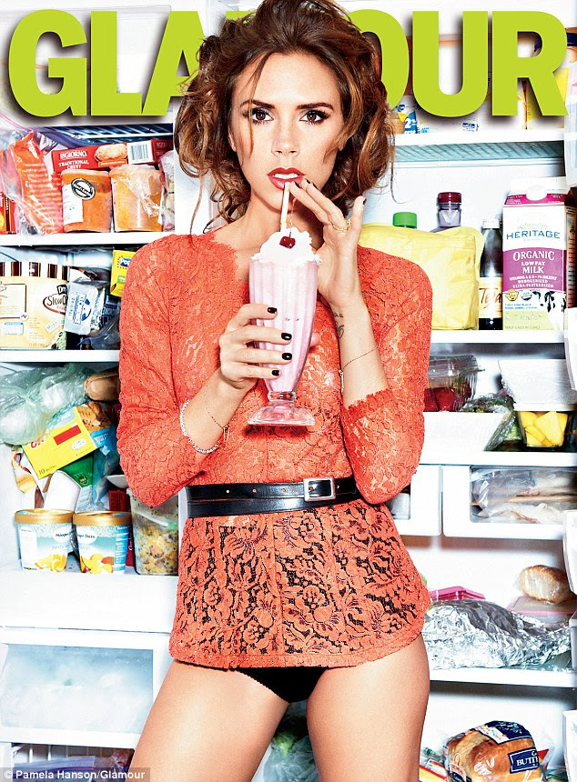 Hungry eyes: Victoria Beckham poses in front of a well-stocked fridge with a milkshake in hand for the new issue of Glamour magazine