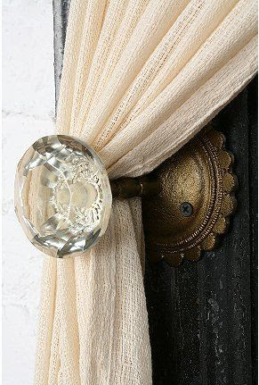 Doorknob as curtain tieback -- we love it, but so much more with an antique doorknob and backplate! And we carry gadgets now that make these very easy to install.