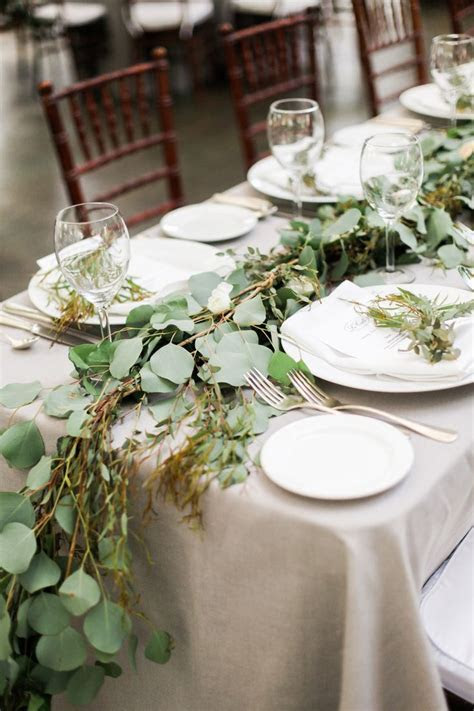 Picture Of a simple greenery table runner and a grey