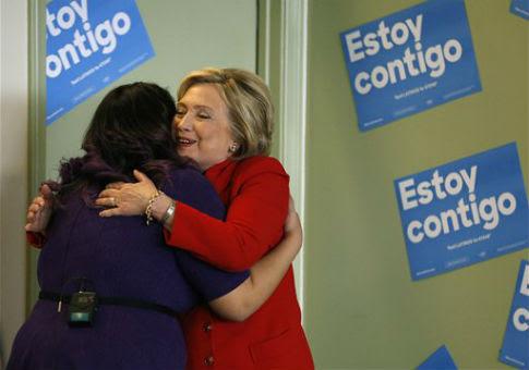 Hillary Clinton, right, hugs immigration activist Astrid Silva / AP
