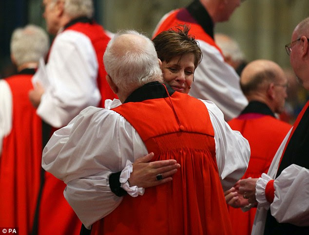 Congratulations: The new bishop hugs another priest during the ceremony