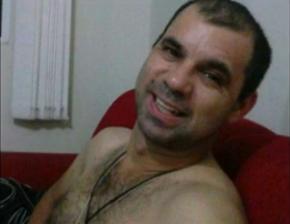 lauri amado de souza nery, preso acusado de jogar óleo e ácido na ex-companheira em joinville (Foto: Reprodução/RBS TV)