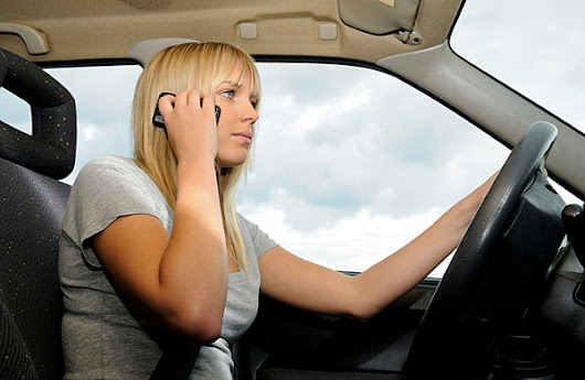 When is using a cell phone while driving permissible?