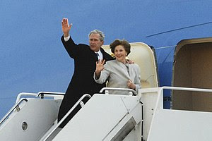 Former President George W. Bush and his wife L...