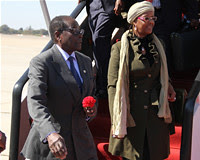 Republic of Zimbabwe President Robert Mugabe with First Lady Grace Amai at Harare International Airport after attending the Rio+20 Summit in Brazil. The UN summit addressed sustainable development. by Pan-African News Wire File Photos