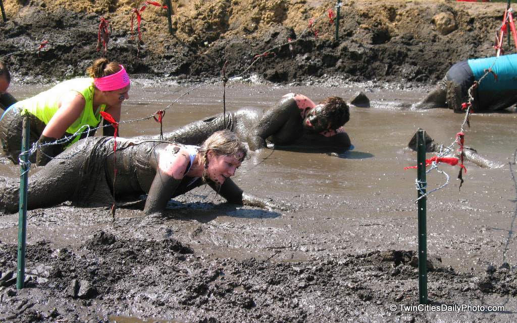 Crawling through the mud at the Warrior Dash was the final obstacle each participant had to endure. Having crawled through the mud myself, watching others do the same made it much more enjoyable.